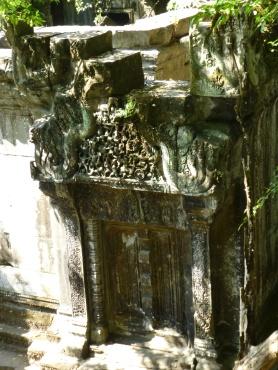 Carved pediment over door