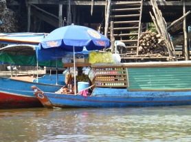 Floating market with Coca Cola and beer