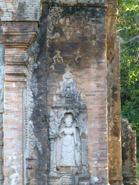 Remnants of stucco Apsaras above statue
