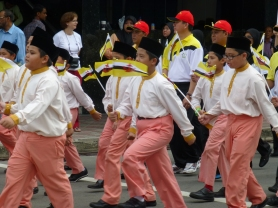 Young boys marching toward the park