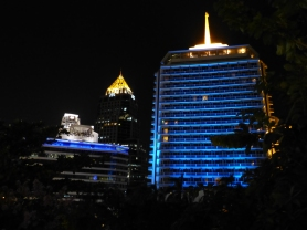 Night view of Dusit Thani with HSBC and Abdul Rahim buildings in background