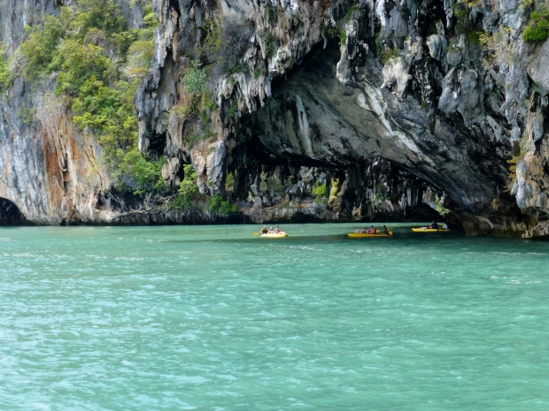 Kayakers under a karst overhang